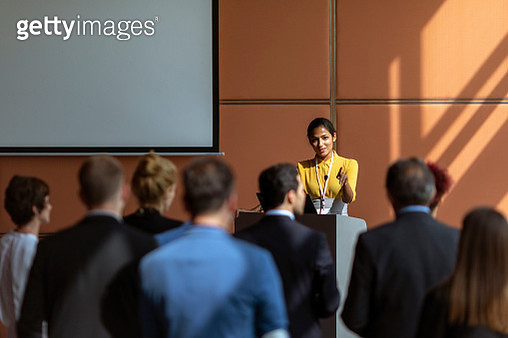 Businesswoman speaking to the audience - gettyimageskorea