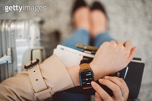 A closeup of lady's hand using smart watch - gettyimageskorea