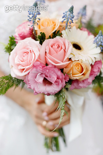 Close-Up Of Bride Holding Bouquet - gettyimageskorea