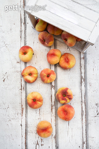 Doughnut peaches, wooden box on white wood - gettyimageskorea