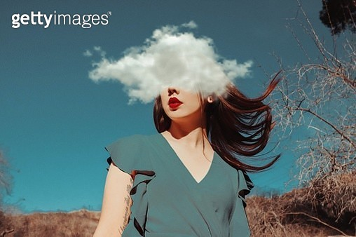 Digital Composite Image Of Young Woman And Cloud Against Sky - gettyimageskorea