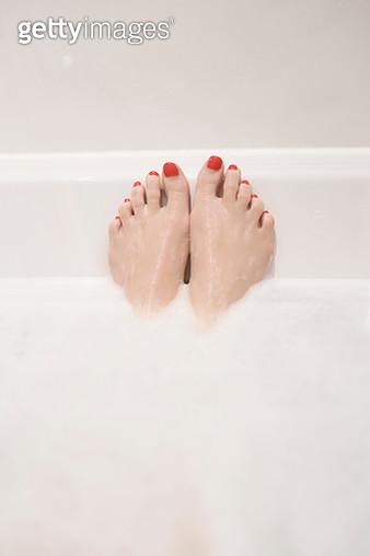 Woman's feet in bath - gettyimageskorea