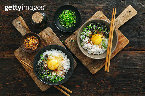 Japanese breakfast Tamago kake gohan (cooked rice topped or mixed with raw egg and soy sauce) - gettyimageskorea