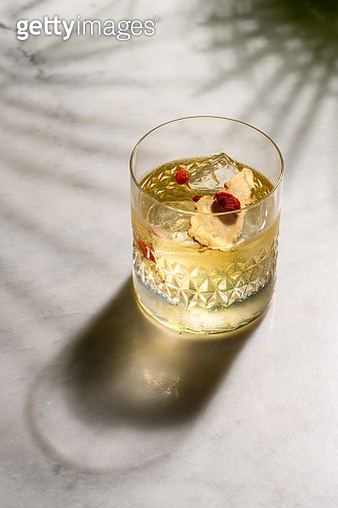 Glass with alcohol and ice cubes - gettyimageskorea