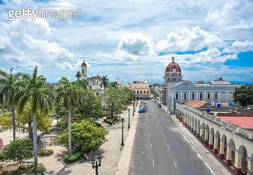 Plaza de Armas, Town Hall and Cathedral with dramatic sky, Cienfuegos, Cuba - gettyimageskorea