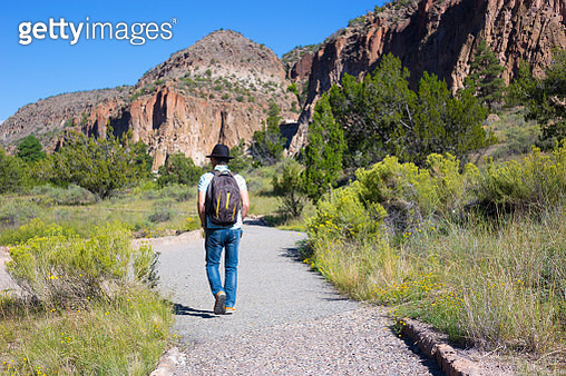 Bandelier National Monument, NM: Senior Man Hikes Past Ruins - gettyimageskorea