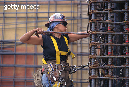 Woman Working with Rebar - gettyimageskorea