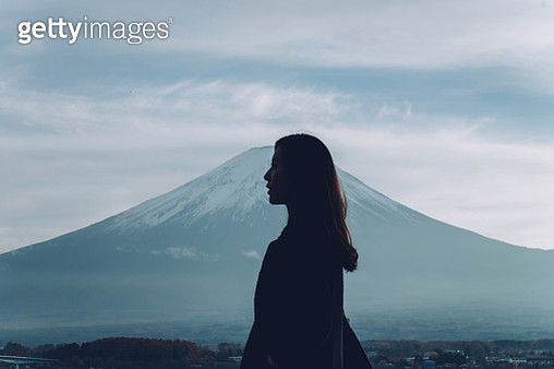 Silhouette of beautiful woman against Mt Fuji and blue sky - gettyimageskorea