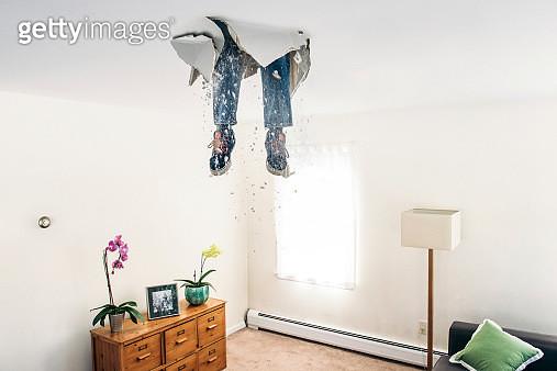 Man breaks ceiling drywall while doing DIY - gettyimageskorea