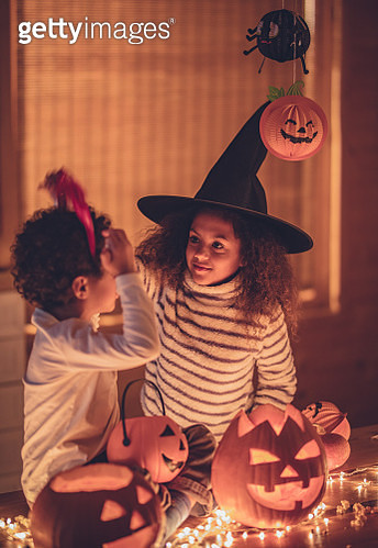 Small African American brother and sister enjoying in Halloween at home. - gettyimageskorea