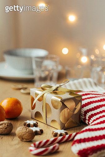 Christmas present, tangerines, walnuts, candy canes and cinnamon stars - gettyimageskorea