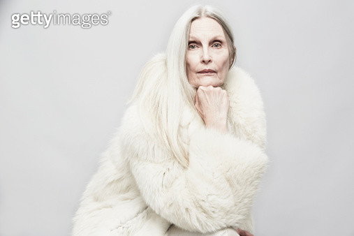 Studio portrait of senior woman with hand on chin - gettyimageskorea