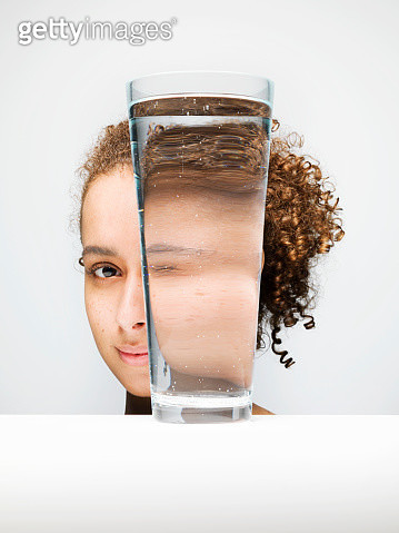 Portrait of female through glass of water - gettyimageskorea