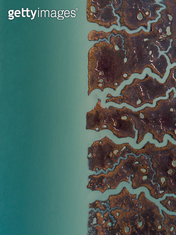 Aerial image above marshlands at the edge of a river, Cadiz, Spain - gettyimageskorea