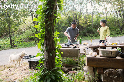 Couples and dogs enjoying barbecue - gettyimageskorea
