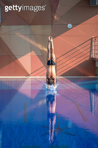 Rear view of young man diving - gettyimageskorea