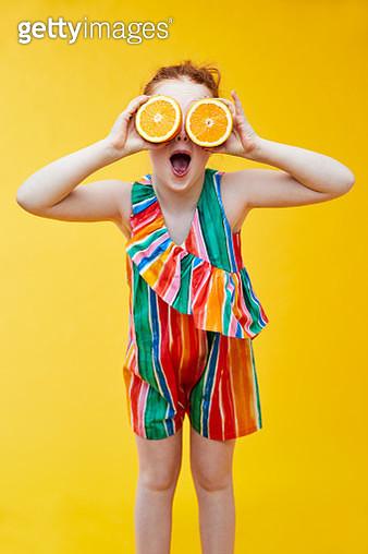 Girl holding oranges - gettyimageskorea