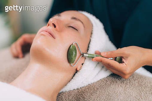 Woman Lying For Beauty Treatment At Spa - gettyimageskorea