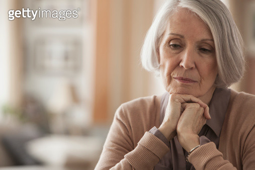 Senior Caucasian woman with chin in hands - gettyimageskorea