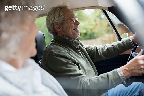 Senior couple driving in car - gettyimageskorea