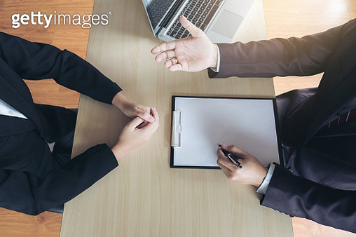 Midsection Of Colleagues Working In Office - gettyimageskorea