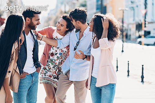 Multi-ethnic group of smiling young people - gettyimageskorea