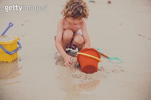 little blonde boy having fun at beach - gettyimageskorea