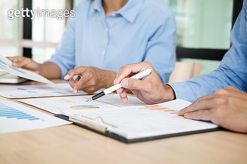 Midsection Of Business Colleagues Discussing At Office - gettyimageskorea