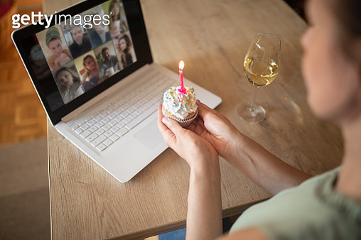 Woman celebrating birthday alone at home - gettyimageskorea