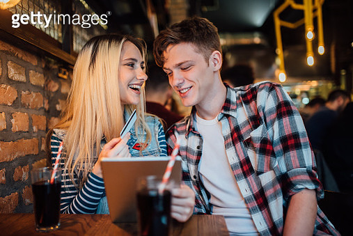 Happy couple using digital tablet - gettyimageskorea