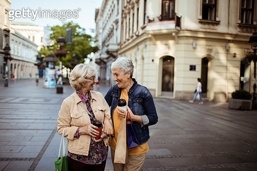 Close up of two senior friends having a walk - gettyimageskorea