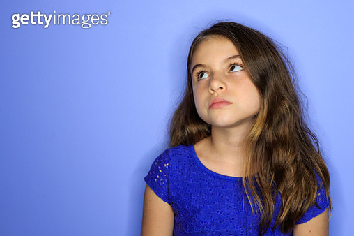Young girl looking up and bored - gettyimageskorea