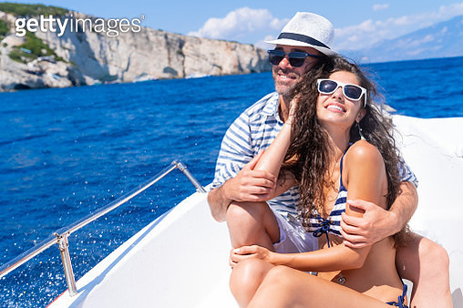 Couple in love enjoying summer vacations on a yacht in Zakynthos Greece - Navagio beach - gettyimageskorea