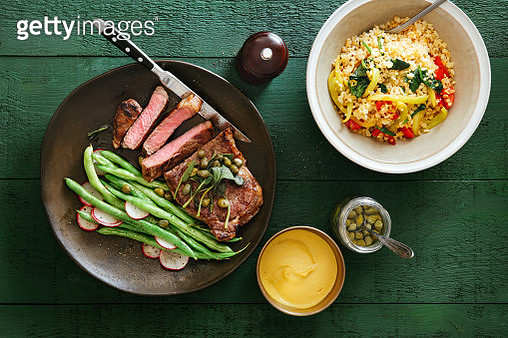 Steak with mustard sauce, vegetables, herbs and capers - gettyimageskorea