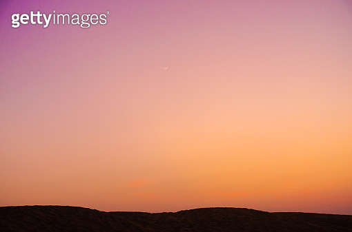 beautiful golden and purple sky and silhouette - gettyimageskorea