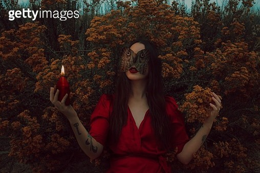 Young Woman Holding Candle And Leaves - gettyimageskorea