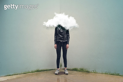 Young woman with head in the clouds - gettyimageskorea