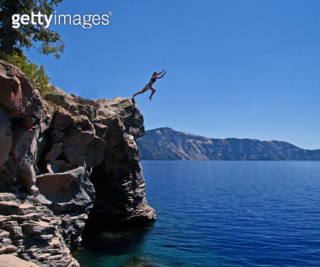 Plunging into Crater Lake of Oregon - a cool, deep, and refreshing swim indeed - gettyimageskorea