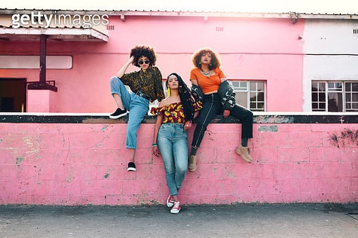 Full length shot of three attractive and stylish young women posing together against an urban background - gettyimageskorea