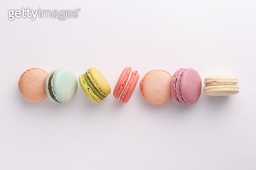 Directly Above Shot Of Colorful Macaroons Arranged On White Background - gettyimageskorea