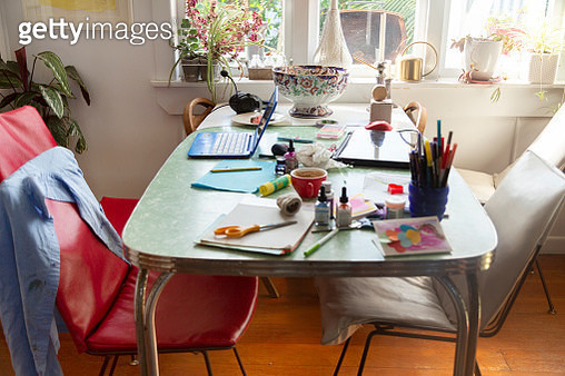 A craft project mess on the kitchen table - gettyimageskorea