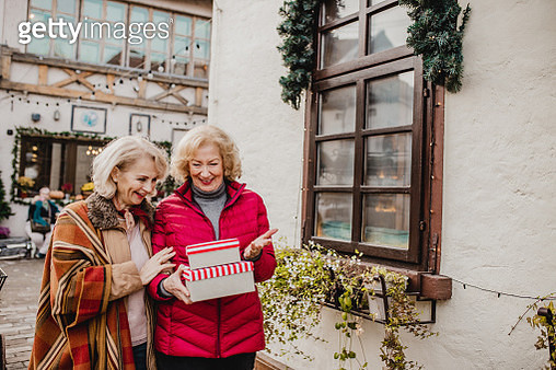 Senior female friends during Holiday season shopping presents - gettyimageskorea