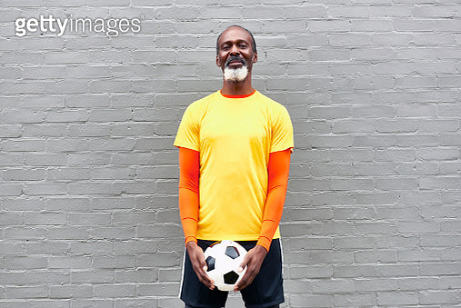 Older man with football - gettyimageskorea
