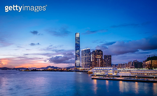 Victoria Harbour with panoramic view of Hong Kong city skyline at sunset - gettyimageskorea