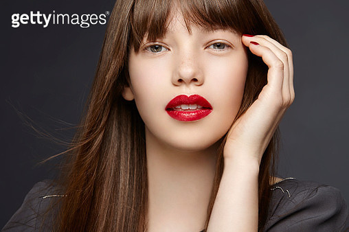 studio shot of a brunette with red , glossy lips - gettyimageskorea