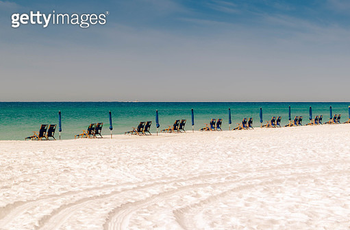 View Of Chairs On Beach Against Sky - gettyimageskorea