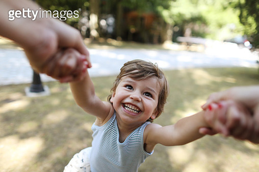 A 3 years old boy having fun in the arms of his mum - gettyimageskorea