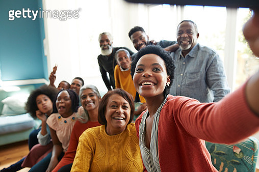 Young woman taking selfie with family and friends - gettyimageskorea
