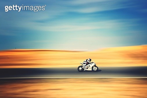 Motorbike Speeding On Country Road - gettyimageskorea