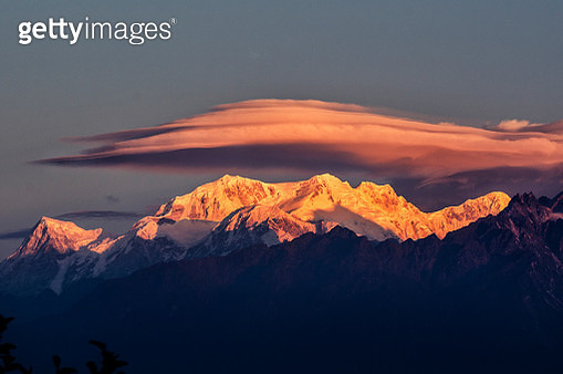 Scenic View Of Snowcapped Mountains Against Sky During Sunset - gettyimageskorea